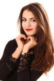L'efficace giovane donna in un vestito nero Fotografia Stock