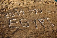 L'Egitto 2017 - scritto nella sabbia sulla spiaggia Fotografia Stock