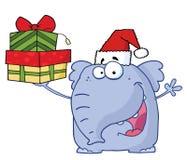 L'elefante di natale sostiene i regali Immagine Stock