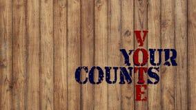 L'elezione trimestrale il vostro voto conta i leters su fondo di legno immagine stock