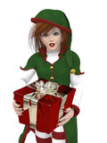 L'elfe de Santa avec le cadeau Photo libre de droits