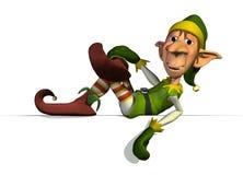 L'elfe de Santa sur le bord de signe Images stock