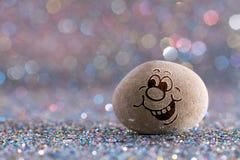 L'emoji en pierre désireux photo stock