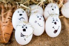 L'emozione differente affronta le uova Fotografie Stock