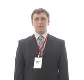 L'employé de bureau avec le blanc badges sur le cou. Photos libres de droits