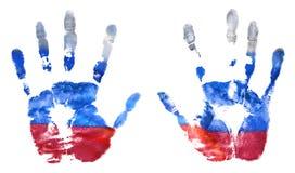 L'empreinte des mains des couleurs russes de drapeau Le drapeau de la Fédération de Russie photos stock