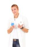 L'enema faux de fixation de docteur d'Atful montrent du doigt au patient Images stock