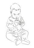 L'enfant avec les peintures se reposant sur le plancher Photographie stock libre de droits