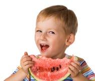 L'enfant avec une pastèque Photographie stock libre de droits
