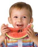 L'enfant avec une pastèque Photos libres de droits