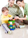 L'enfant construit une maison avec des brevets Photographie stock libre de droits