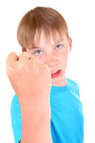 L'enfant menacent par un poing Photographie stock
