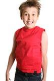 L'enfant sautant et souriant image stock
