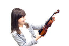 L'enfant tient le violon et le sourire Photo stock