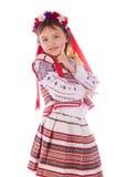 L'enfant, une fille dans une robe lumineuse. Photographie stock