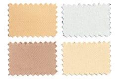L'ensemble d'échantillon rapièce le tissu de couleur d'isolement sur le blanc Photos stock