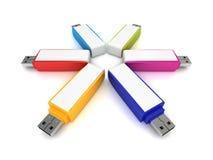 L'ensemble d'éclair coloré d'USB conduit sur le blanc Photos libres de droits