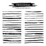 L'ensemble d'aquarelle noire, encrent les courses tirées par la main de brosse, frontières Photographie stock