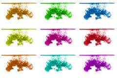 L'ensemble d'encre multicolore opacifie sous l'eau d'isolement sur le fond blanc encre dans l'eau avec la ligne de flottaison, ba Photographie stock libre de droits