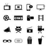 L'ensemble d'icônes plates noires s'est rapporté au cinéma, aux films et à l'industrie cinématographique Photo libre de droits