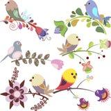 L'ensemble d'oiseaux se reposant sur des fleurs dirigent l'illustration Photo stock
