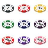 L'ensemble de casino coloré ébrèche sur un fond blanc Photographie stock libre de droits