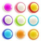L'ensemble de descripteurs lustrés colorés de bouton a isolé Photographie stock libre de droits