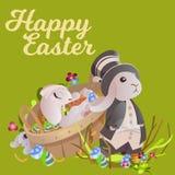 L'ensemble de panier de lapin de chasse à oeufs de chocolat de Pâques sur l'herbe verte a décoré des fleurs, oreilles drôles de l Images libres de droits