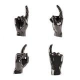 L'ensemble de plastique noir abstrait différent remet le fond blanc Un doigt vers le haut Image stock