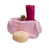L'ensemble de produits de beauté en produits de beauté roses mettent en sac d'isolement Photographie stock libre de droits