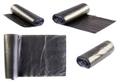 L'ensemble de sacs de déchets en plastique noirs de polyéthylène roulent sur le CCB de lumière photographie stock