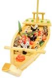 L'ensemble de sushi de petits pains sur le bateau a formé le plat Photo libre de droits