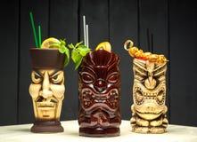 L'ensemble de trois cocktails avec l'orange et la menthe Photos stock