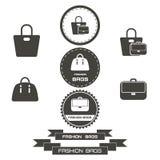 L'ensemble de vintage met en sac à la mode des logos, emblèmes, éléments Photo stock