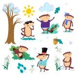 L'ensemble heureux de jour de Groundhog, marmotte mignonne dans le cylindre tient la fleur - le perce-neige blanc, prévision de t Images libres de droits