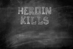 L'eroina uccide il messaggio sulla lavagna Immagine Stock Libera da Diritti