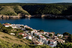 L`Escala and bay view from top of hill. Large bay between rocky hills in Catalonia Royalty Free Stock Images