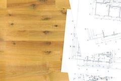 L'espace de travail de l'architecte avec des plans de maison Image stock