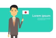 L'espace japonais de Banner With Copy d'homme d'affaires d'affaires d'homme de prise de drapeau asiatique du Japon Images libres de droits