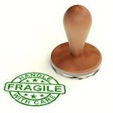 L'estampille fragile en bois affiche les produits cassables Photo stock
