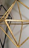 L'estratto calcola il nero e un oro di due rombi Immagine Stock Libera da Diritti