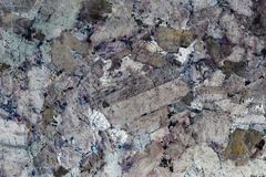 L'estratto si è formato da un primo piano di una superficie lucidata della pietra fotografia stock