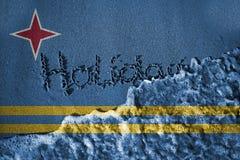 L'estremità del segno di festa ed il mare ondeggiano il fondo o strutturano con il mescolamento delle bandiere di Aruba Immagini Stock