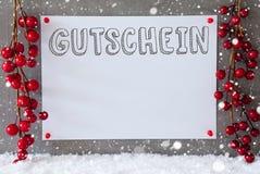 L'etichetta, fiocchi di neve, decorazione di Natale, Gutschein significa il buono Immagini Stock
