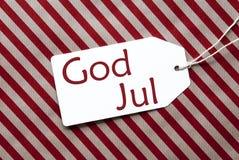L'etichetta su carta da imballaggio rossa, Dio luglio significa il Buon Natale Immagini Stock