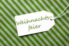 L'etichetta su carta da imballaggio verde, Weihnachtsfeier significa la festa di Natale fotografia stock libera da diritti