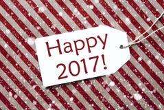 L'etichetta su carta rossa, fiocchi di neve, manda un sms a 2017 felice Fotografie Stock Libere da Diritti