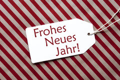 L'etichetta su carta rossa, Neues Jahr significa il buon anno Immagini Stock