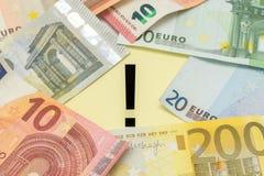 L'euro del punto esclamativo nota i soldi Fotografia Stock