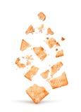 L'explosion du biscuit dans des morceaux photos libres de droits